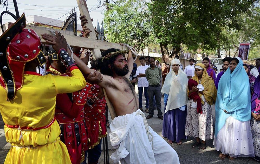 Christians at a Good Friday procession at St. Francis Church in Bhopal.