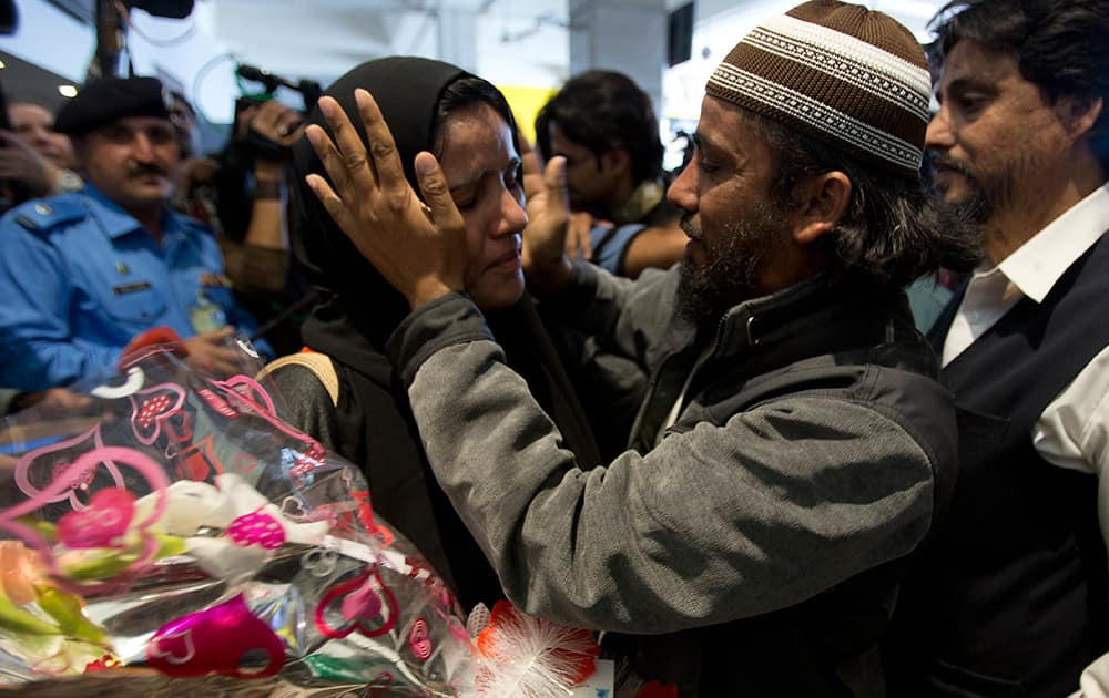 A Pakistani woman evacuated from Yemen is greeted by her family member at Islamabad airport in Pakistan.