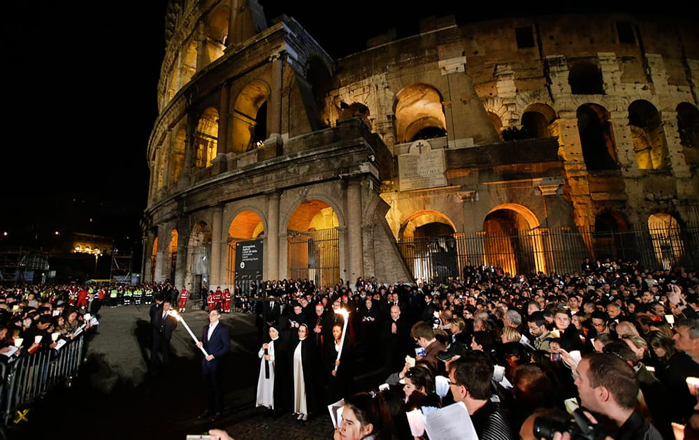 Nuns hold hold the cross during a station of the Via Crucis (Way of the Cross) torchlight procession celebrated by Pope Francis in front of the Colosseum on Good Friday, in Rome