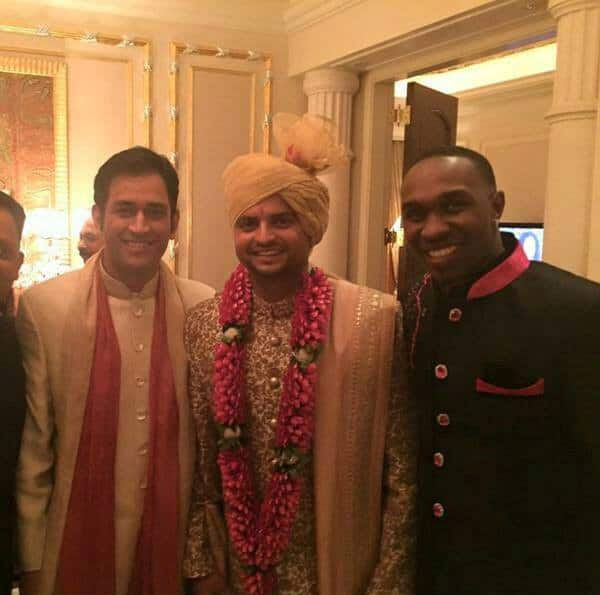 MS Dhoni and D Bravo at the marriage ceremony of Suresh Raina (C) in New Delhi.