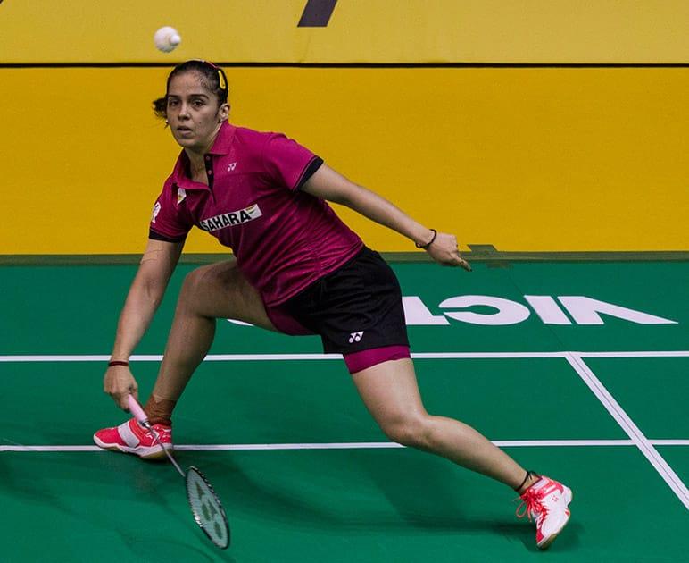 Saina Nehwal returns a shot to China's Li Xuerui during their women's singles semifinal match at the Malaysia Open badminton tournament in Kuala Lumpur.