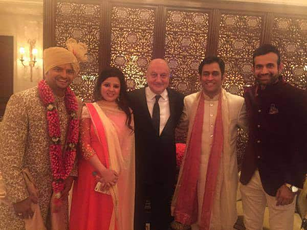 MS Dhoni, his wife Sakshi, Irfan Pathan and actor Anupam Kher at the wedding ceremony of Suresh Raina (L) in New Delhi