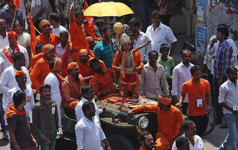 A Hindu boy, dressed as Hanuman, participates in a procession on Hanuman Jayanti in Hyderabad.