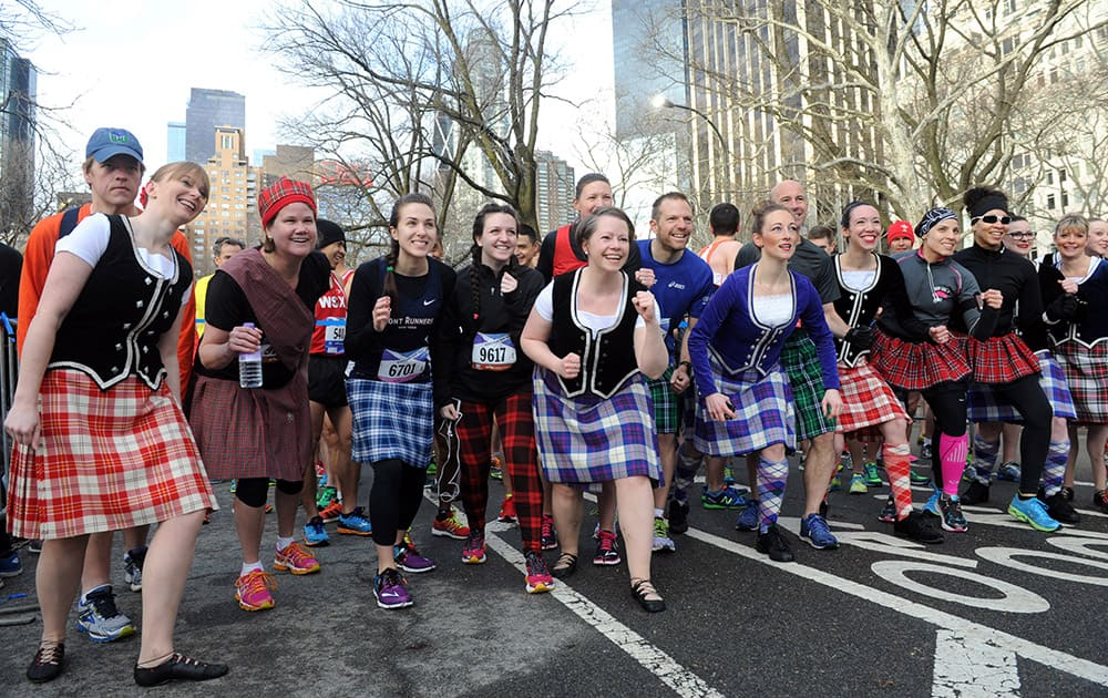 Runners and dancers kick-off the 12th annual Scotland Run in New York's Central Park to celebrate Scotland Week festivities.