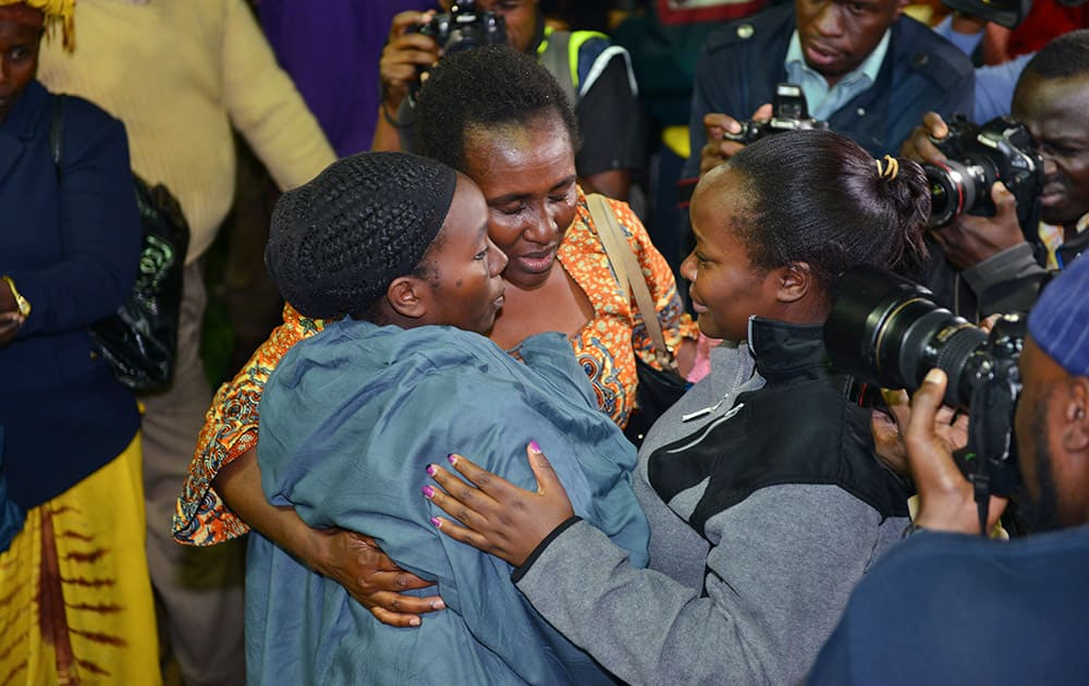 Relatives react together as some of the 663 students who survived the Garissa University College terror attack arrive in Nairobi Nyayo stadium, Kenya.