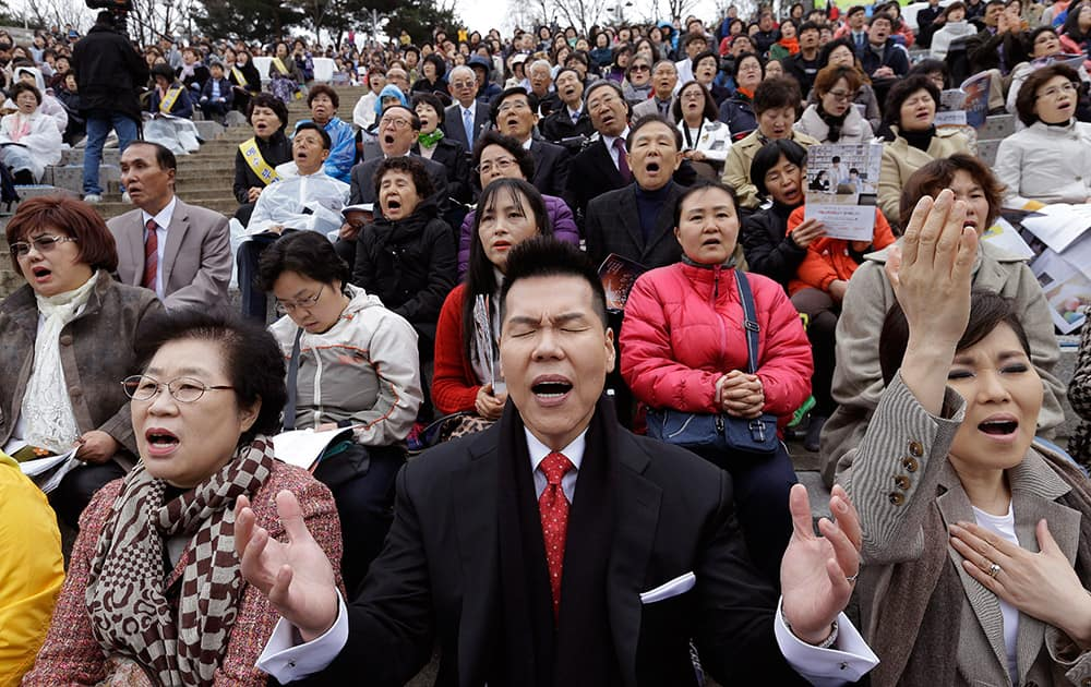 South Korean Christians pray during an annual Easter service rally at Yeonsei University in Seoul, South Korea.