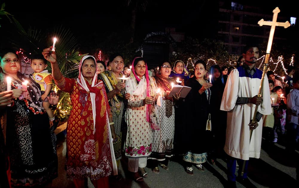 Pakistani Christians chant prayers during Easter service in Karachi.