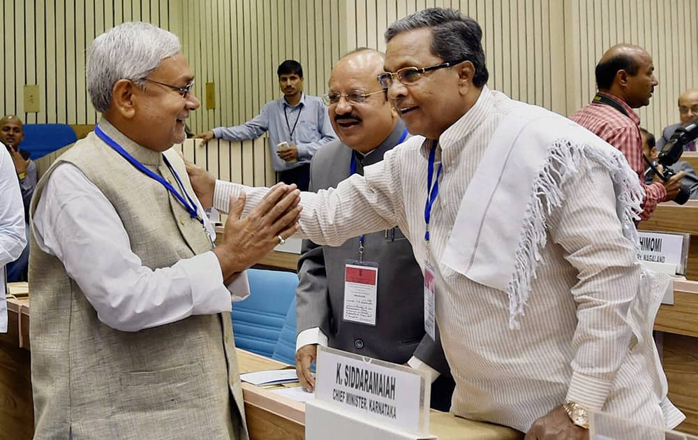 Bihar CM Nitish Kumar with Karnataka CM K Siddaramaiah during the inauguration of the joint conference of the CMs and the CJs of High Courts at Vigyan Bhawan in New Delhi.