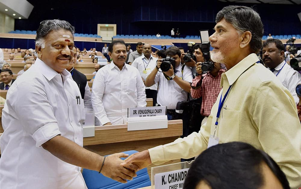 Andhra Pradesh CM N Chandrababu Naidu shakes hand with Tamil Nadu CM O Panneerselvam during the inauguration of the joint conference of the CMs and the CJs of High Courts at Vigyan Bhawan in New Delhi.