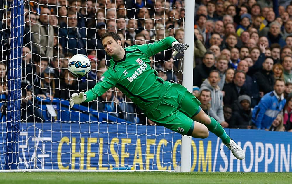 Stoke's Asmir Begovic makes a save during the English Premier League soccer match between Chelsea and Stoke City at Stamford Bridge stadium in London.