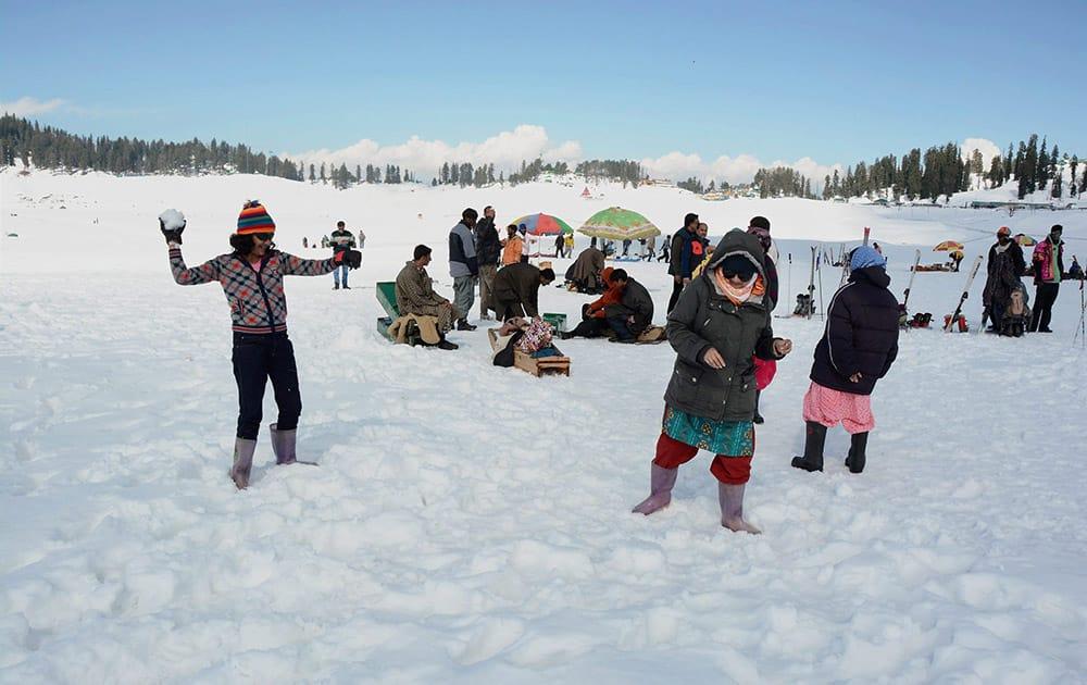 Tourists enjoy in snow at Gulmarg near Srinagar.
