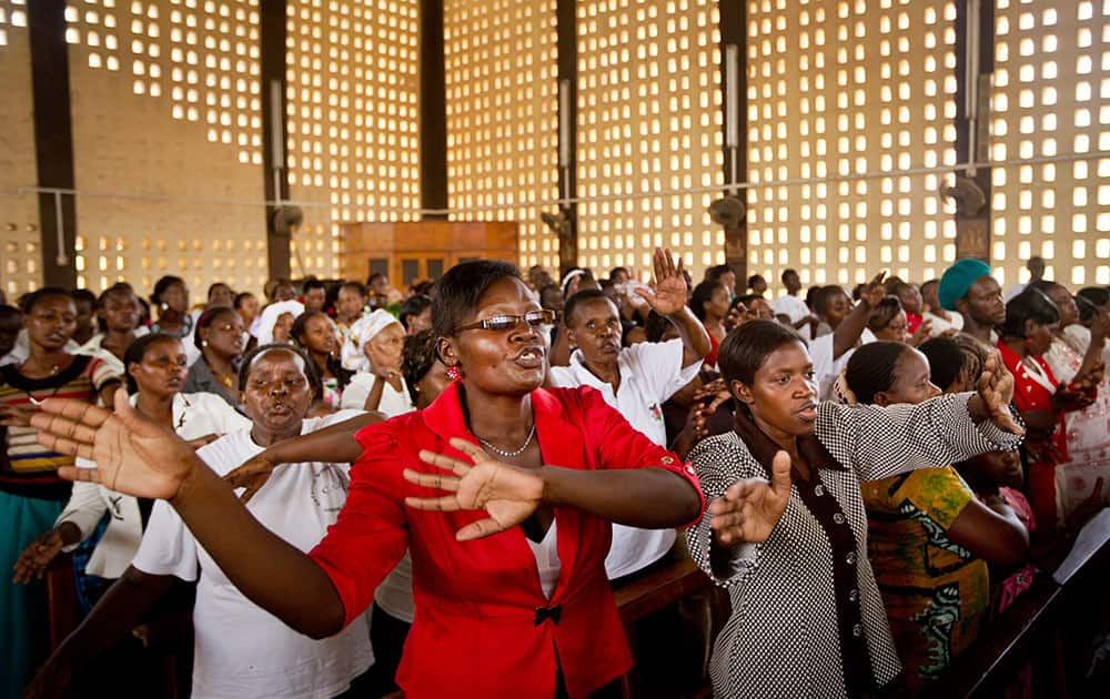 Christians sing during the service at the Our Lady of Consolation Church, which was attacked with grenades by militants almost three years ago, in Garissa, Kenya.
