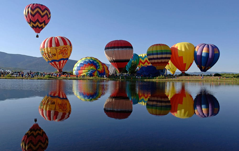 This photo provided by Steamboat Ski Resort shows hot air balloons that visitors can tour in above the town and mountains in Steamboat Springs, Colo.