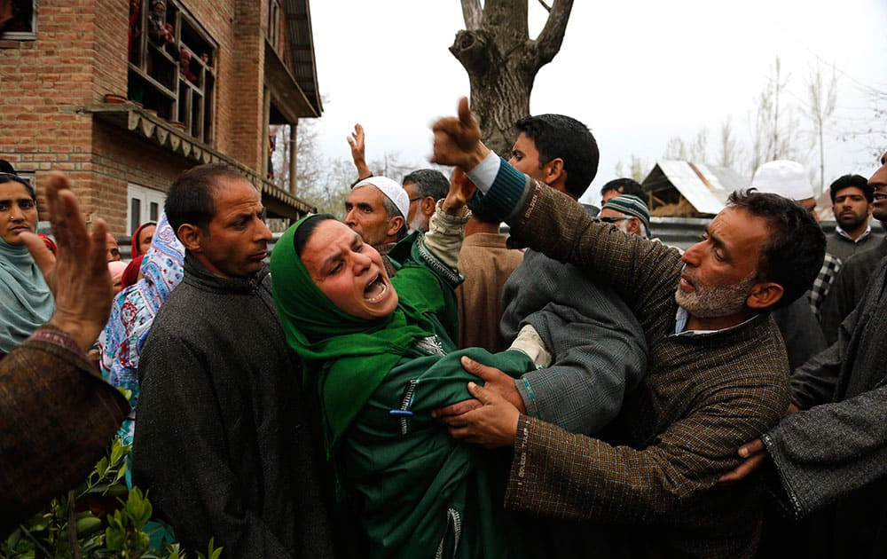 An unidentified relative of Mushraq Ahmad, an Indian policeman shot dead by suspected rebels, wails during his funeral procession in Arigam, some 32 Kilometers (20 miles) south of Srinagar, India.