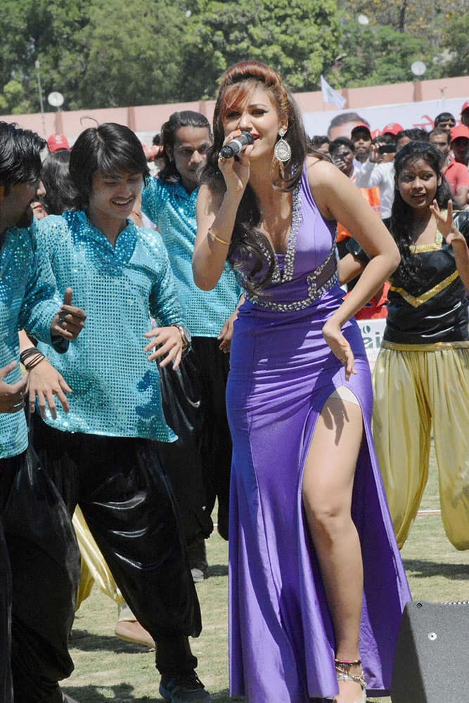A singer performs during the inauguration ceremony of Indian Gramin Cricket League (IGCL) in Lucknow.