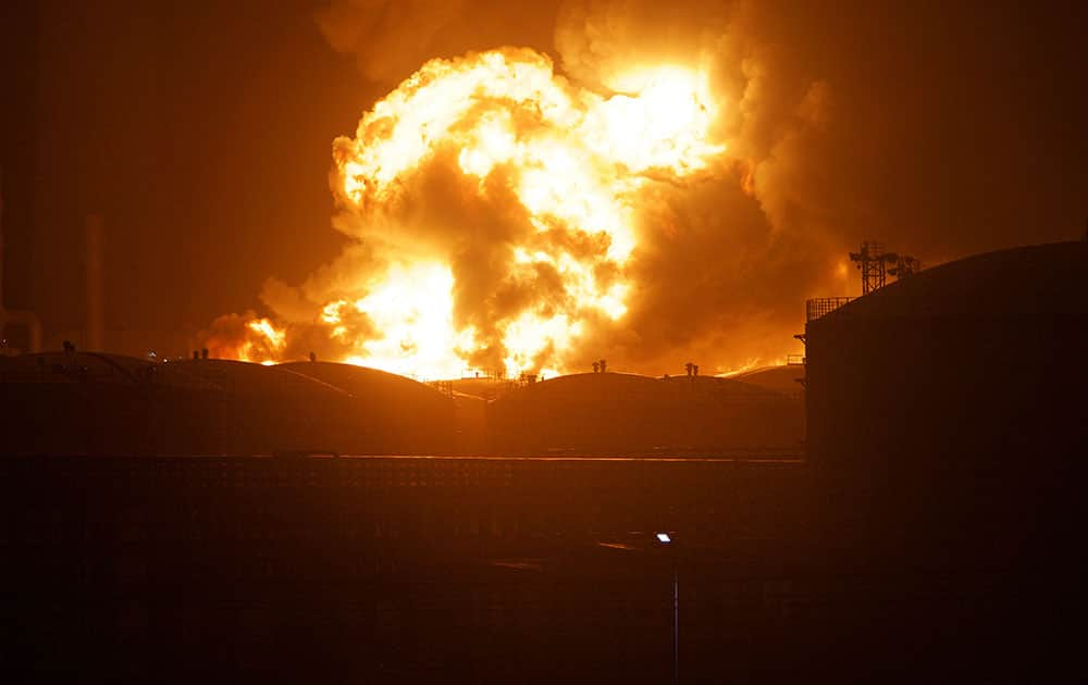 flames rise from a chemical plant in Zhangzhou, southeast China's Fujian Province.