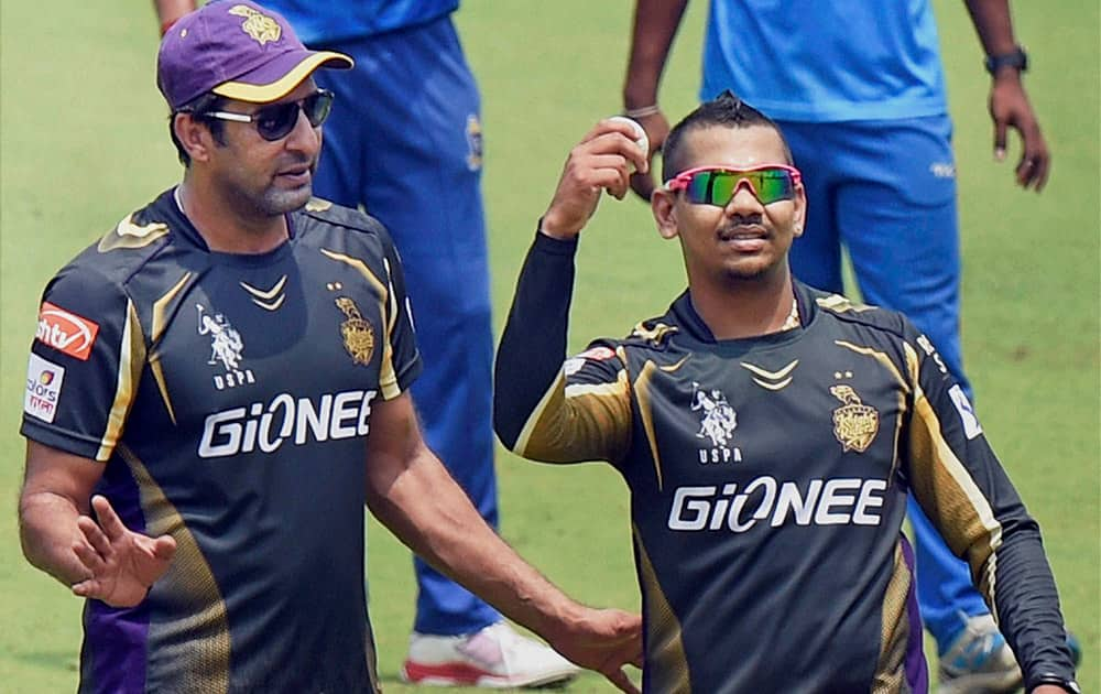 KKR player Sunil Narine and bowling coach Wasim Akram during a practice session at Eden Garden in Kolkata.