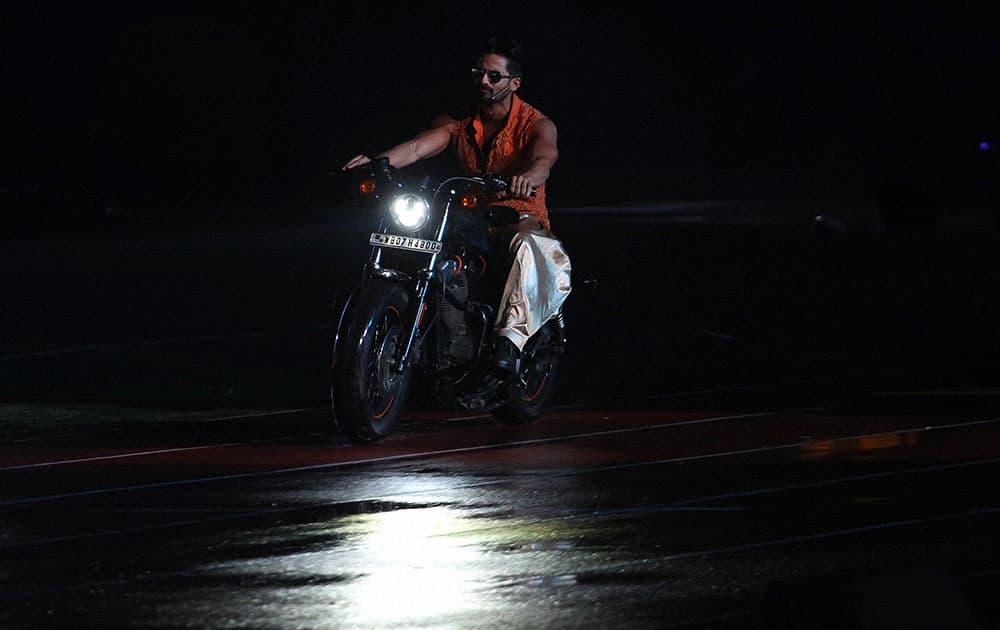 Bollywood Actor Shahid Kapoor performs during the Pepsi IPL 2015 opening night event at the Salt Lake Stadium in Kolkata.