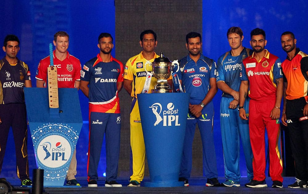 Captain from all IPL team with IPL Trophy during the Pepsi IPL 2015 opening night event held at the Salt Lake Stadium in Kolkata.