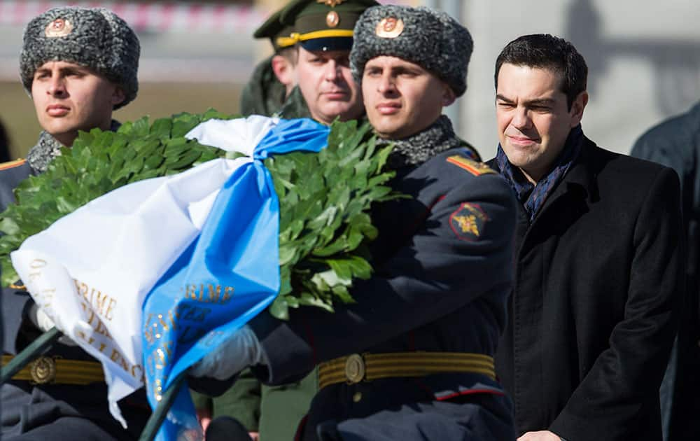 Greek Prime Minister Alexis Tsipras, right, takes part in a wreath laying ceremony at the Tomb of the Unknown Soldier in Moscow, Russia.