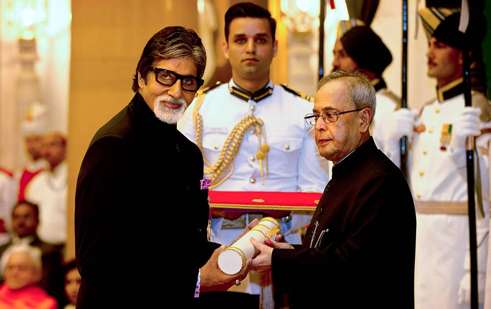 President Pranab Mukherjee confers the Padma Vibhushan to Bollywood superstar Amitabh Bachchan, during a civil investiture ceremony at the presidential palace in New Delhi.