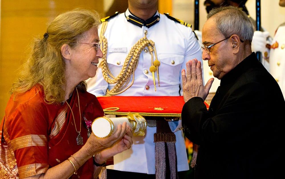 President Pranab Mukherjee, confers the Padma Shri to Austria born Indology scholar Bettina Sharada Baumer during a civil investiture ceremony at the presidential palace, in New Delhi.