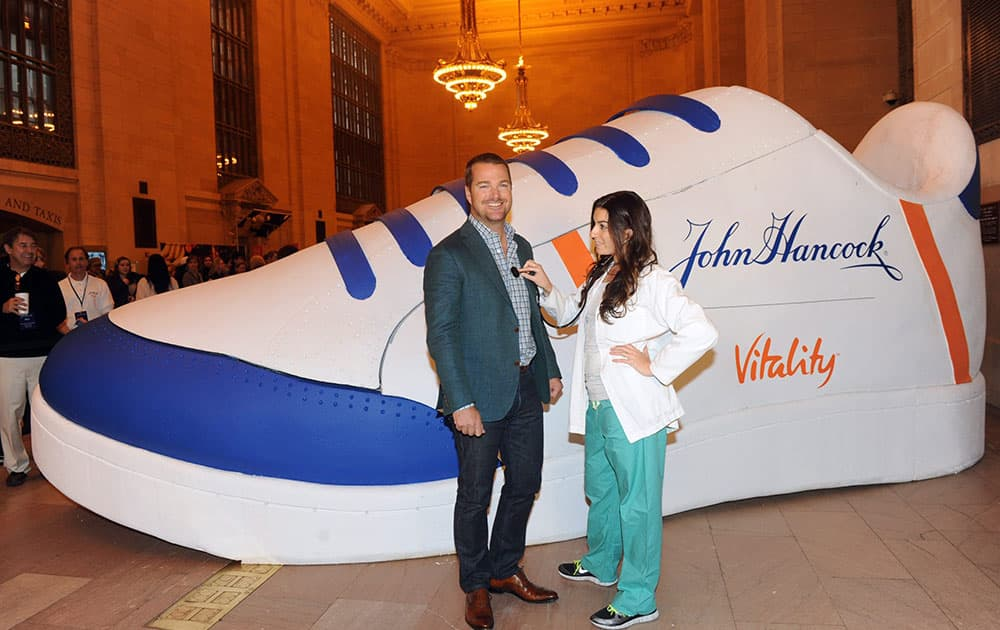 Chris O'Donnell poses for a quick check-up from physician assistant Amy Forleiter at the John Hancock Vitality Village in New York.