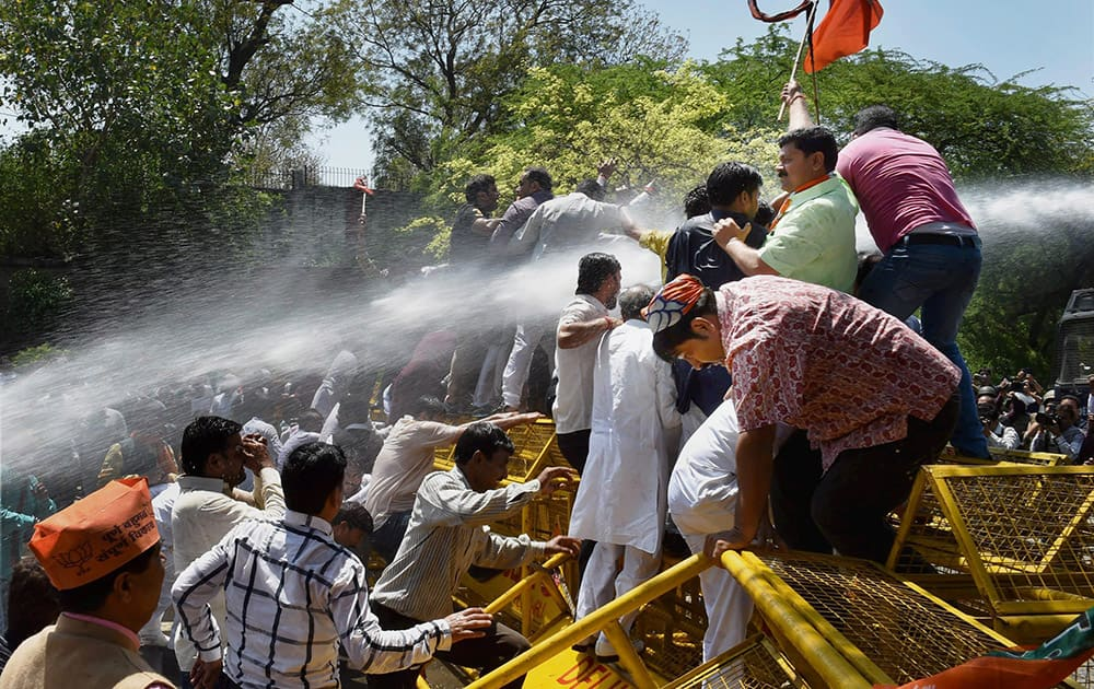 Police personnel use water cannons to disperse the BJP workers as they protest near Delhi CM Arvind Kejriwals residence over the Turkman Gate road-rage incident, in New Delhi.