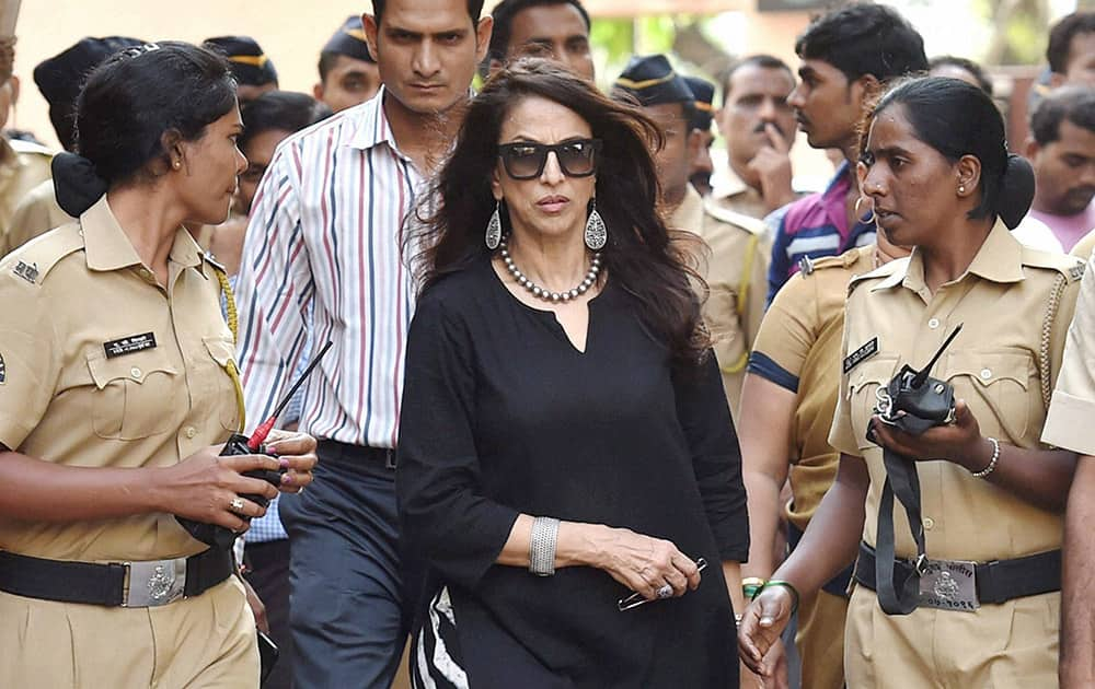Celebrity writer Shobhaa De with police security after Shiv Sena activists protested outside her residence for her criticism against Maharashtra government's move of making screening of Maratha films mandatory for multiplexes during prime time, in Mumbai.