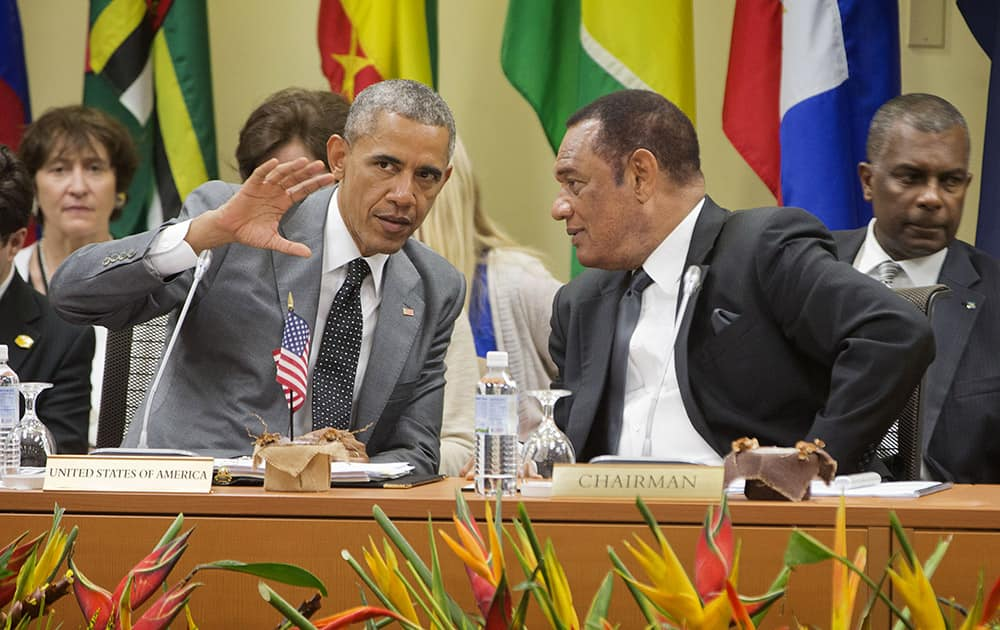 President Barack Obama talks with Prime Minister of Bahamas Perry G. Christie, at the summit with Caribbean Community (CARICOM) leaders, in Kingston, Jamaica.