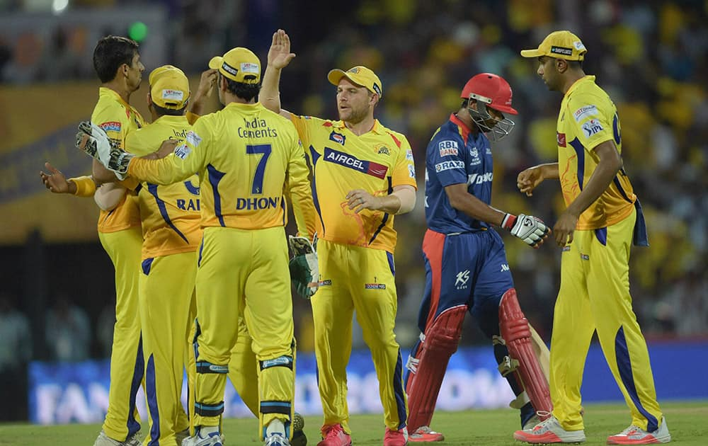 Chennai Super Kings' Ashish Nehra celebrates along with teammates after dismissing a Delhi Daredevils batsman Shreyas Iyer during their IPL-2015 match against Delhi Daredevils at MAC Stadium in Chennai.
