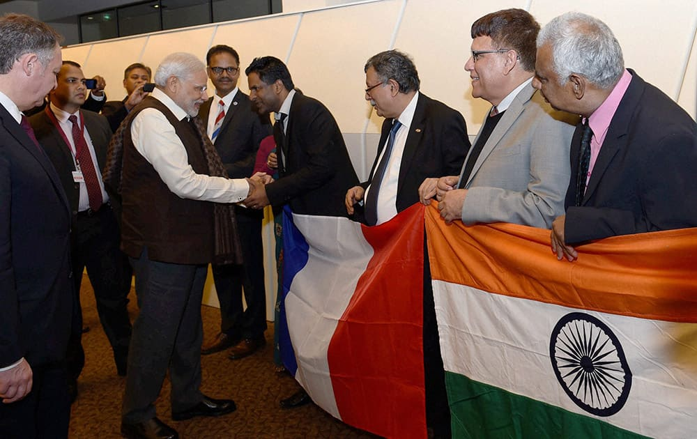 Prime Minister Narendra Modi meets people of Indian community upon his arrival at the Paris Orly International airport in France.