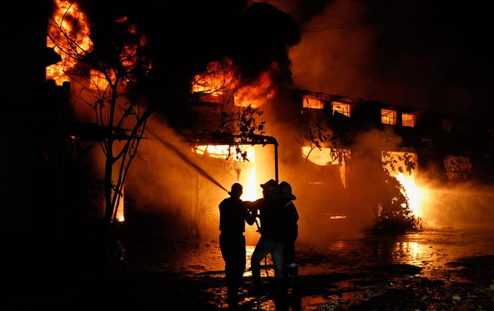 Firemen try to douse a fire that broke out in a warehouse of a lubricant company in Ahmadabad.
