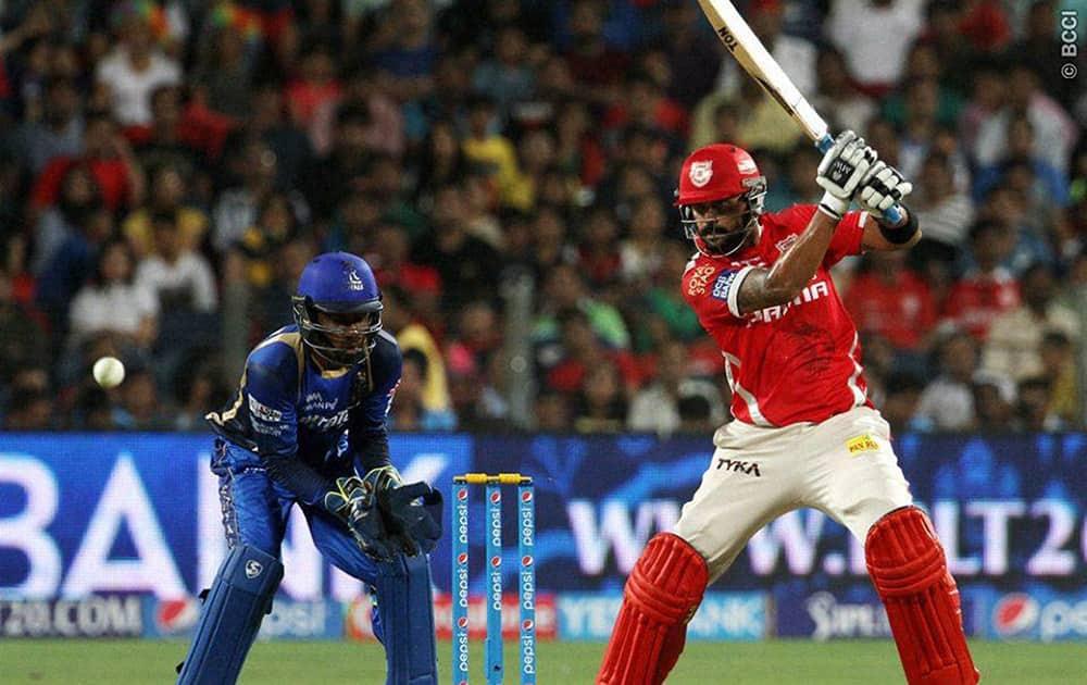 Kings XI Punjab player Murali Vijay plays a shot during the IPL 2015 match against Rajasthan Royals in Pune.