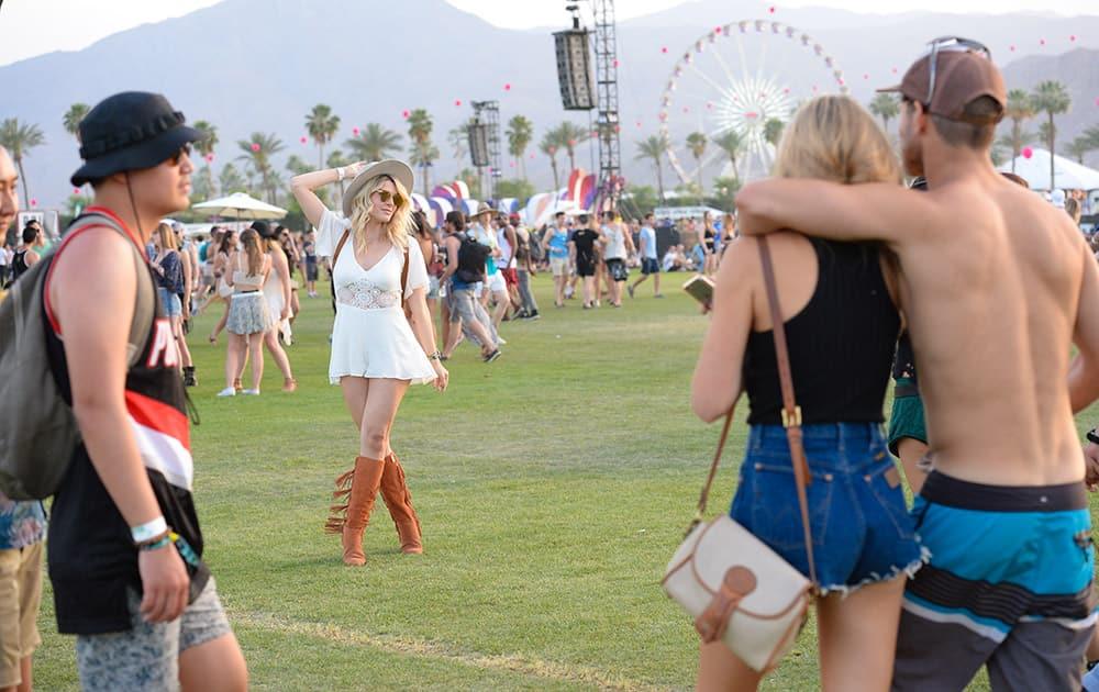 Festival goers enjoy the 2015 Coachella Music and Arts Festival, in Indio, Calif.