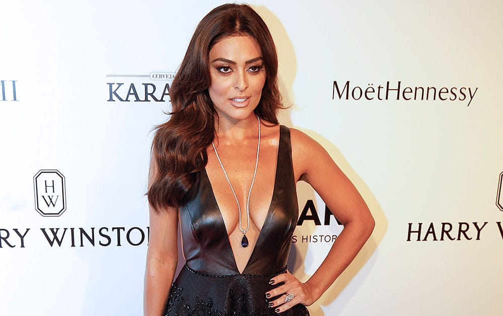 Brazilian actress Juliana Paes poses on the red carpet at a Foundation for AIDS Research (amfAR) event in Sao Paulo, Brazil.