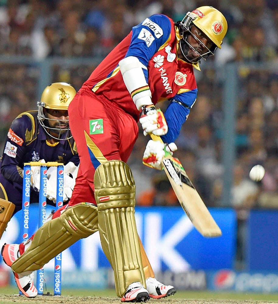 RCB player Chris Gayle plays a shot against Kolkata Knight Riders during an IPL-2015 match at Eden Garden in Kolkata.