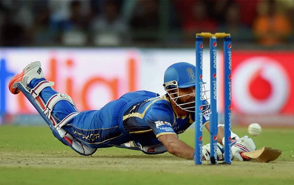Rajasthan Royals batsman Ajinkya Rehane dives during an IPL match against Delhi Daredevils in New Delhi.