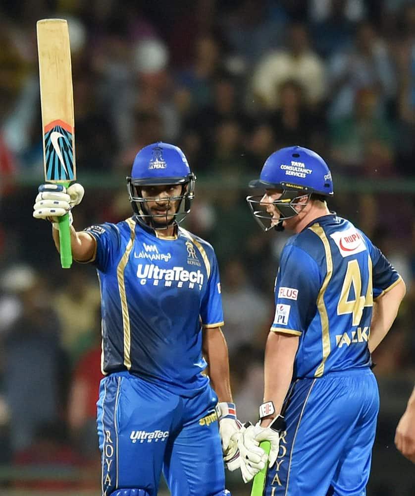 Rajasthan Royals batsman Deepak Hooda raises his bat after completing his half century during an IPL match against Delhi Daredevils in New Delhi.