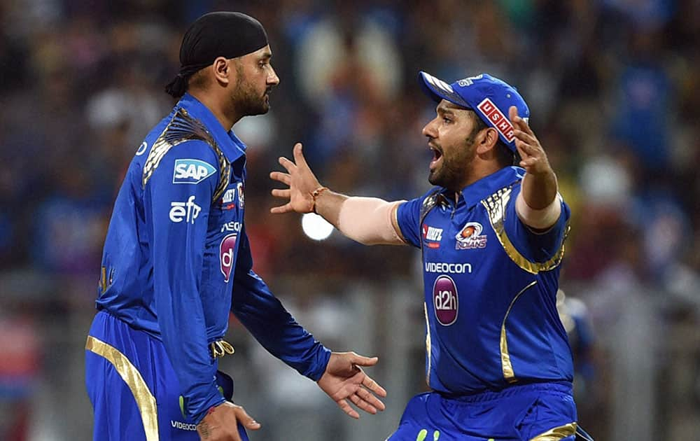 Mumbai Indians bowler Harbhajan Singh celebrates the wicket of Kings XI Punjab batsman Sehwag plays during the IPL T20 match played in Mumbai.
