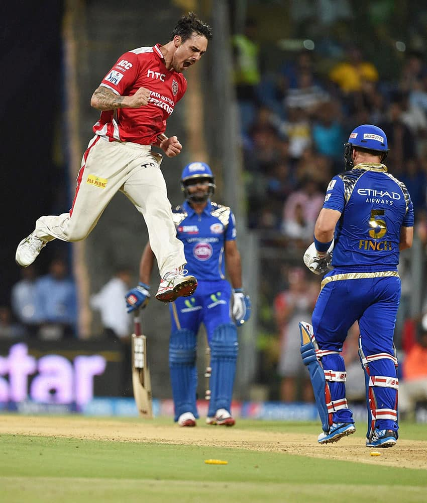 Kings XI Punjab bowler Mitchell Johnson celebrates a wicket of Mumbai Indians batsman Aaron Finch during a IPL T20 match played in Mumbai.