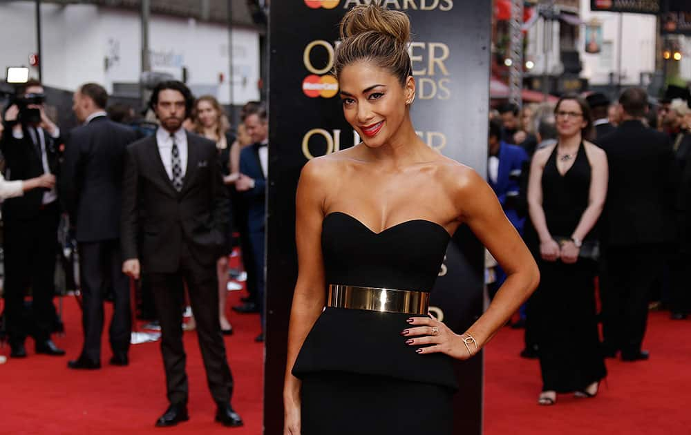 Singer Nicole Scherzinger poses for photographers upon arrival at the Olivier Awards at the Royal Opera House in central London.