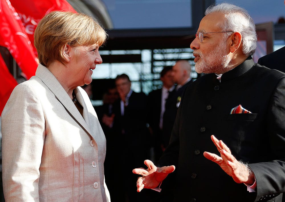 German Chancellor Angela Merkel welcomes India's Prime Minister Narendra Modi at the opening of the industrial fair in Hanover, Germany.