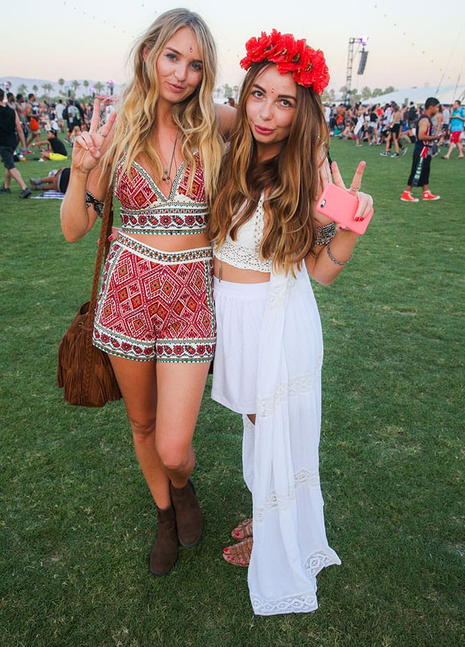 Festival goers Charlotte Peppard, left, and Ruby Hook, of Milton Kings, England, attend the 2015 Coachella Music and Arts Festival, in Indio, Calif.