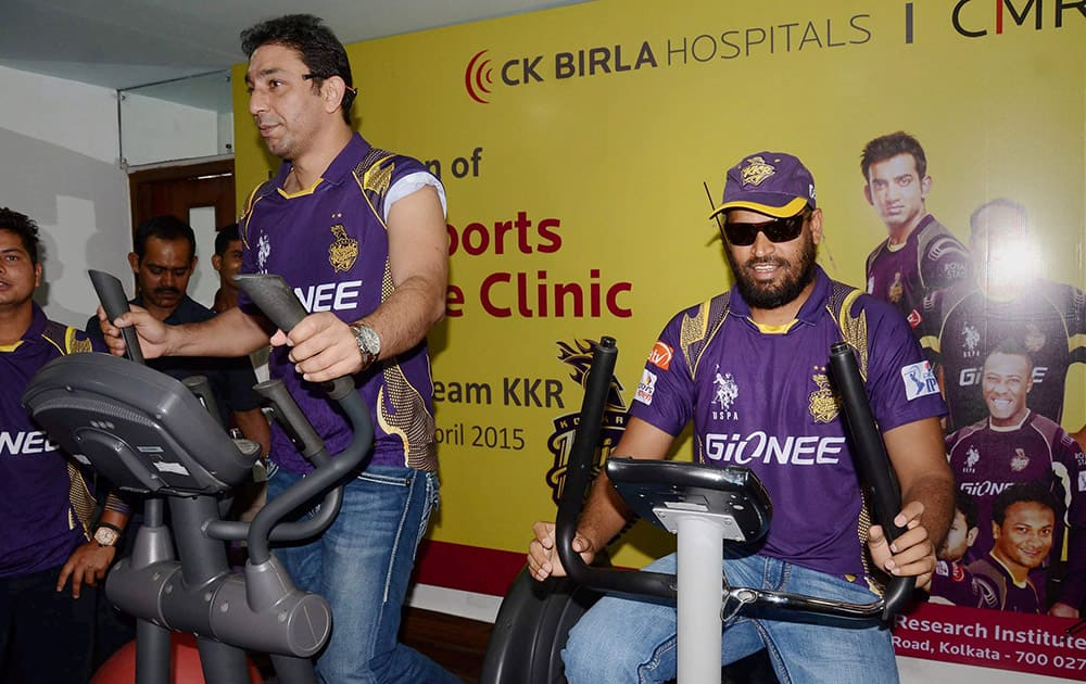 KKR players Yusuf Pathan and Azhar Mahmood at the launch of Sports Medicine clinic at Calcutta Medical Reserach Institute Hospital in Kolkata.