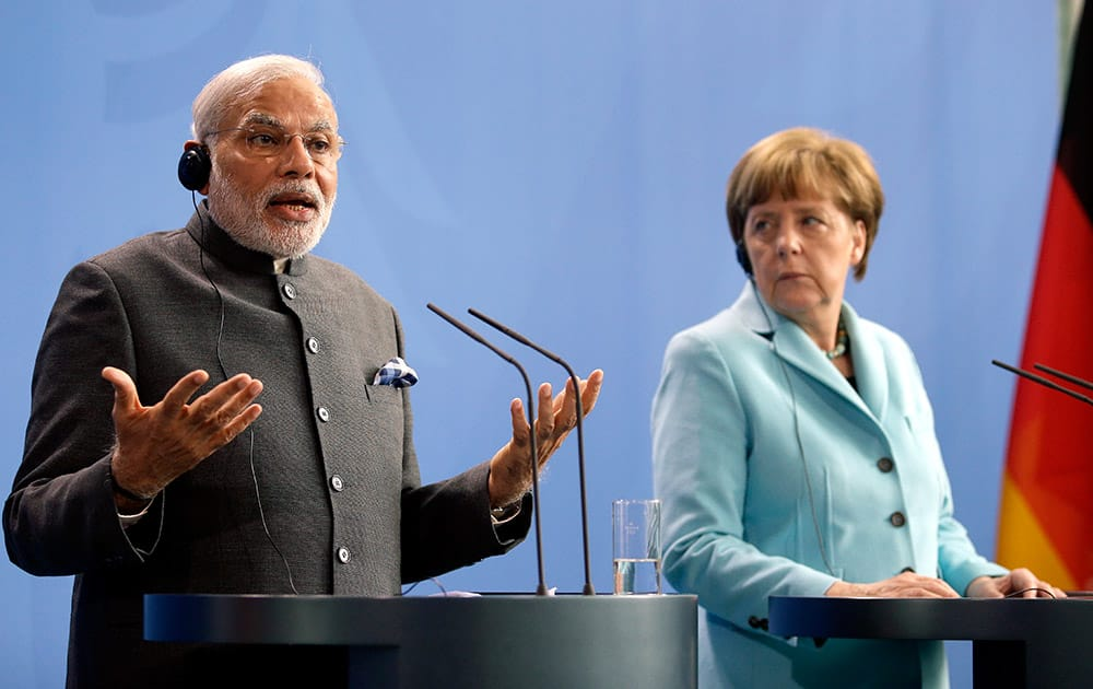 German Chancellor Angela Merkel and the Prime Minister of India Narendra Modi address the media during a joint press conference as part of a meeting at the Chancellery in Berlin, Germany.