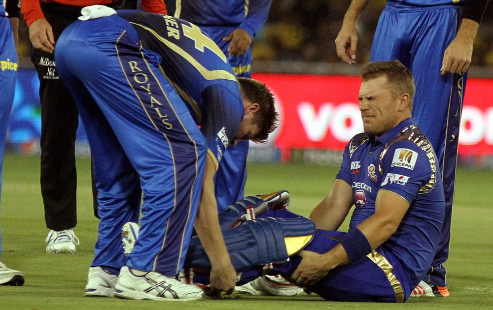 Mumbai Indians player Aaron Finch reacts after being hit by a ball during their IPL 2015 between Rajasthan Royals and Mumbai Indians at the Sardar Patel Stadium.