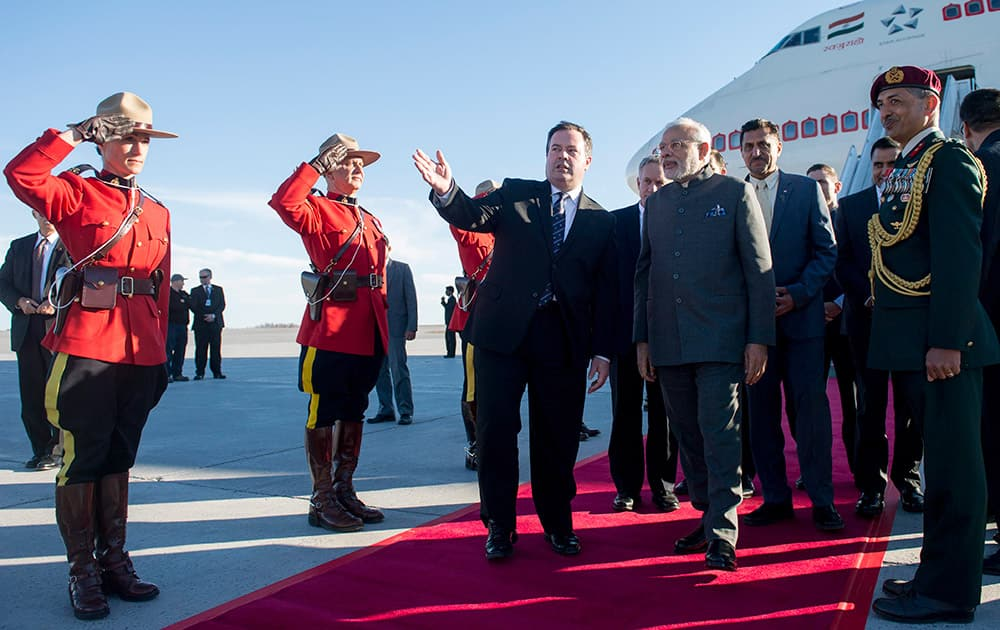 Minister of National Defense Jason Kenney walks with PM Narendra Modi as he arrives at arrives at Ottawa, Ontario, for a state visit.