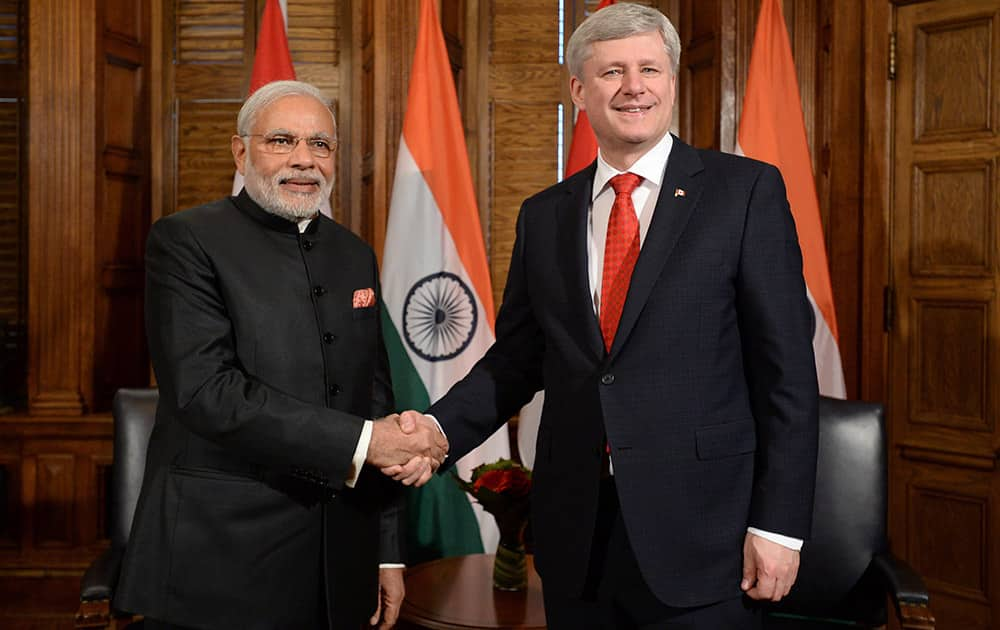 Prime Minister Narendra Modi takes part in a meeting with Prime Minister Stephen Harper in his office on Parliament Hill in Ottawa.