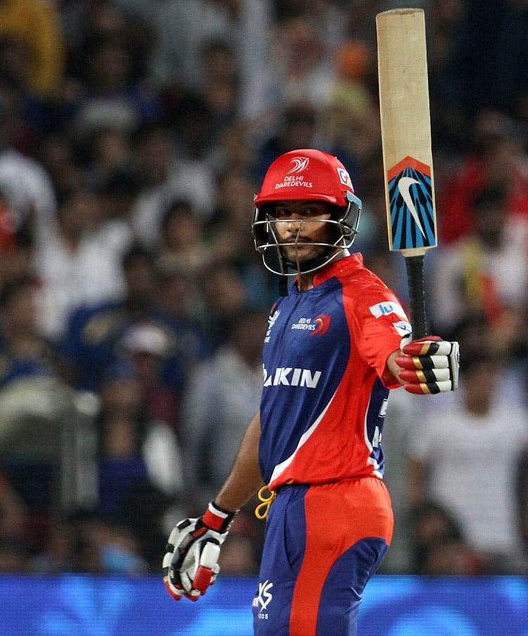 Daredevils player Mayank Agarwal raises his bat after scoring a fifty against Kings XI Punjab during an IPL T20 match in Pune.